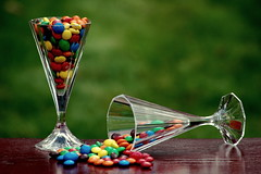 Colourful Drink (HaHa UK) Tags: blue friends red orange green classic glass colors grass yellow vintage table glasses colorful chocolate chocolates peanuts refraction mm soe mahogany chocs blueribbonwinner supershot bej worldbest goldstaraward
