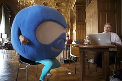 Photo of Druplicon sitting for a Job interview at the Job fair
