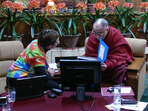 Adele presenting the Dalai Lama her book