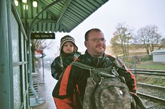 monroe and jonathan waiting for the max, thanksgiving day (cafemama) Tags: thanksgiving travel november max cold travelling rain daddy publictransit publictransportation jonathan thanksgivingday babywearing hollywood transportation monroe lightrail 2009 transitcenter jonathanhanson hollywoodtransitcenter monroegilberthanson monroehanson november2009