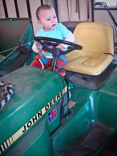 trying out papa's tractor...