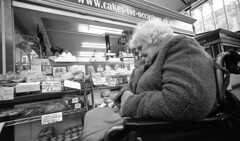 Keeping Warm (4foot2) Tags: candid candidportrate streetphoto streetshot street streetphotography people peoplewatching interestingpeople manchester manchesterpeople lady oldlady wheelchair reportagephotography reportage stockport greatermanchester market cakes food analogue film filmphotography 35mm 35mmfilm 15mm voigtlander15mm voigtlander superwideangle rangefinder 1932 1932leica leica111 zonefocus guess closeup close leica bw blackandwhite monochrome mono rolleiretro rolleiretro400s 400s rodinal standdevelop 2017 fourfoottwo 4foot2 4foot2photostream 4foot2flickr