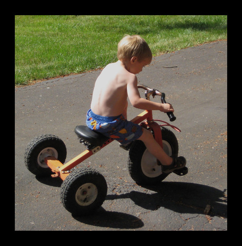 Riding his Tricycle