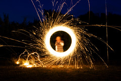 Sparkles of Fire (Audiotribe) Tags: longexposure light color colour art nature sparkles night canon circle denmark fire eos exposure magic experiment nat ring round blaze sparkler sparks feuer lys spark danmark ild eksperiment gnist stjernekaster gnister 400d hipbotunsquare glder gld todbjerg