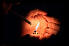 Try not to SMOKE !! (alsultanarts) Tags: canon fire eos hand cigarette smoke smoking ring lighter 450d flickrlovers