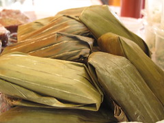 Coconut and plantain steamed pudding in banana leaves