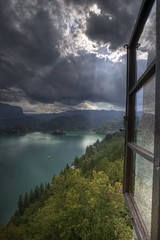 Lake Bled (Castle view) (Bas Lammers) Tags: light sun lake castle window water canon ray explorer slovenia bled hdr photomatix 50d