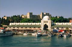 Rhodes, Ρόδος (angelsgermain) Tags: sea boats island town market harbour towers greece shops newmarket fortress rhodes mandraki aegeansea medievaltown knightscastle dodecannese flickrestrellas