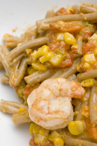 Shrimp Pasta with corn, roasted tomatoes, and poblano cream 11
