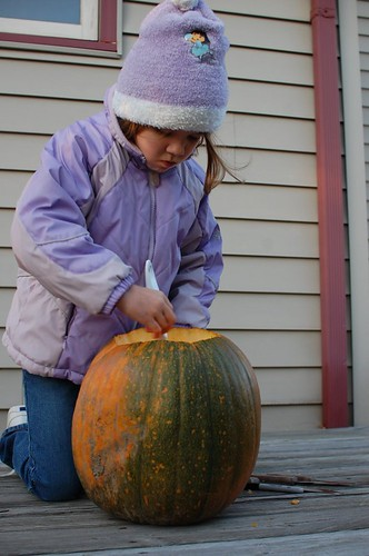Hannah scooping out her pumpkin