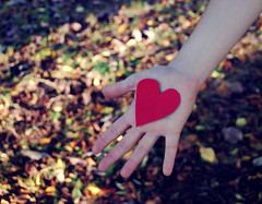 Your heart in my hand. (maggyvaneijk) Tags: autumn light red sun colour cute green leaves cutout focus afternoon shadows hand open heart bokeh bare fingers palm tips wrist tones sleve