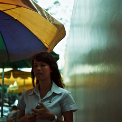 (e l l i o t t i n w o n d e r l a n d) Tags: street woman 6x6 film girl thailand temple fuji bangkok candid kingdom hasselblad medium thep carlzeiss  krung  elliottinwonderland elliottchouraqui