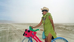 rider on the storm (AcroYogi) Tags: party portrait people green girl sunglasses bike bicycle festival nevada olive playa burningman blackrockcity brc ladybug hualapai blackrockdesert outerlimits deepdesert ttitd brc09