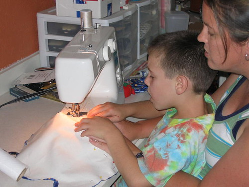 Little man sewing