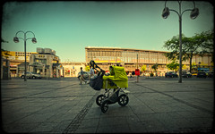 A baby in Berlin: Bahnhof Zoo (manganite) Tags: street family boy panorama baby black blur color berlin station architecture digital photoshop vintage buildings catchycolors germany dark de geotagged iso100 kid blurry xpro nikon colorful europe child tl stroller framed streetphotography blurred frame newborn stitching cropped d200 f80 nikkor dslr buggy 112 vignette bahnhofzoo day112 lightroom leander takuma lensblur structured nikond200 18200mmf3556 manganite colorefexpro y02 filterforge 1200sec geo:lat=52506335 repost1 date:day=24 9raw 1200secatf80 date:year=2009 leandertakuma format:orientation=landscape format:ratio=1610 date:month=mai geo:lon=13333229