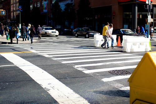 Two volunteers from the Open House New York staff and BHRA set up traffic barriers and remove the manhole in the intersection of Atlantic Avenue and Court Street in Brooklyn.