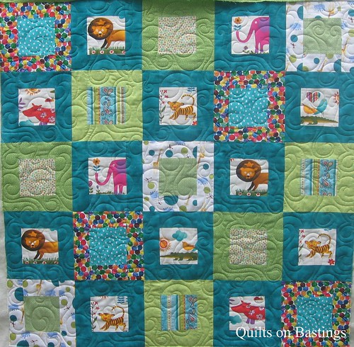 have quilted this baby quilt with an allover swirly design called  Free Baby Quilt Patterns Modern