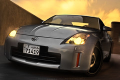 Nissan 350z (Talal Al-Mtn) Tags: orange black cars car yellow canon silver inch automobile nissan shot stock twin gear tire automotive system turbo automatic manual 20 rims 350z exhaust inaction talal hks v6 inmotion nitto nissan350z kwt 450d canon450d lm10 gready inkuwait tokoyodrift almtn talalalmtn  bytalalalmtn