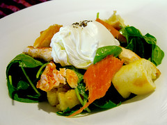 Organic poached egg with smoked arctic char on a salad of mixed baby spinach greens & garlic fried croutons dressed with Dijon vinaigrette.