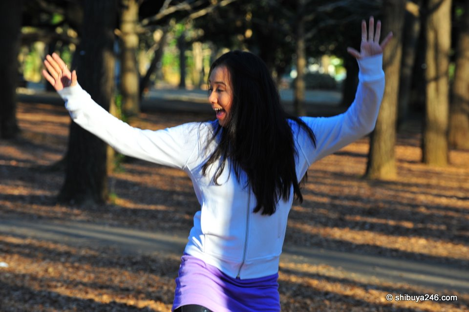 My niece dancing in Yoyogi Park, New Years Day, imitating the cosplay dancers nearby.