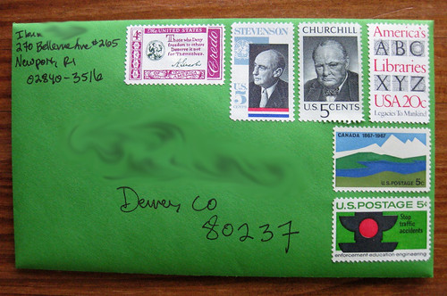 Vintage stamps on green envelope