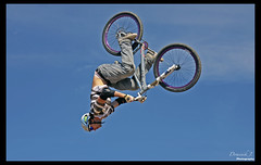 Big in Bavaria. ( Dominik J. Photography) Tags: blue summer sky bike sport clouds canon munich mnchen fun bayern deutschland bavaria big contest mountainbike sigma pros biker messe jakob neue dominik dirtjump riem jumpcontest