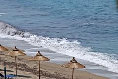 bamboo umbrellas (venetia koussia) Tags: blue seagulls swimming sundown geranium rockybeach sandybeach sporades skiathosisland summeringreece  greekfona