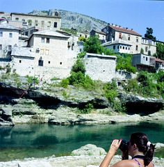 Yes, she had taken photos about the Stari Most :-) (peterkend) Tags: camera houses woman green film river mostar femme clean hasselblad scanned analogue neretva starimost bosniaandhercegovina zsuzska82