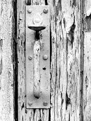 doorhandle (chrisinplymouth) Tags: door peelingpaint doorhandle cw69x cw69d monochrome grayscale