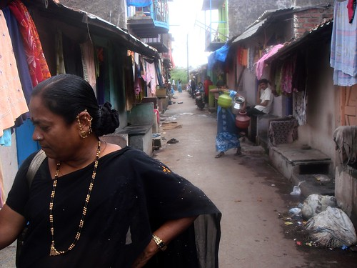 Kamalabai Pani stands in the alley