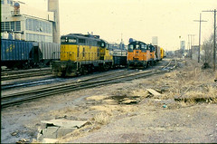 The Mitchell Belt yard in Milwaukee, WI. on March 31, 1979. (extra156west) Tags: road railroad wisconsin train milwaukee mitchell emd cnw gp7 sw1200