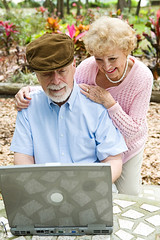 Senior Couple on Computer - Vertical (homecaregiverstore@gmail.com) Tags: park family people woman man male senior beautiful hat smiling vertical female computer garden hair beard fun outdoors happy person reading couple european technology message married florida laptop internet gray handsome lifestyle husband email communication help mature together blond elderly learning wife instant teaching heterosexual typing enjoyment active browsing intelligent caucasian