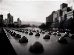 limpet invasion (mugley) Tags: city bridge urban blackandwhite bw blur 120 film lines metal closeup skyline rollei buildings mediumformat river prime vanishingpoint 645 rivets order dof skyscrapers bokeh steel towers overcast australia melbourne wideangle victoria scan southbank negative rows yarra epson bolts polarizer 6x45 r3 mamiya645 urbanlandscape redfilter wideopen xtol f35 polariser aligned 25a v700 sandridgebridge mamiya645protl m645 rolleir3 35mmf35sekorn