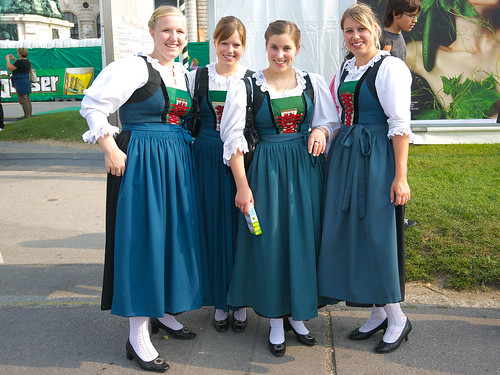 "Austrian ladies pose in traditional wear known as ""Dirndl"" at a farmers market in Vienna, Austria. (flicker image)"
