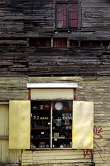 (Jessie Reeder) Tags: chile travel patagonia building deleteme9 window southamerica shop wall architecture graffiti savedbythedeletemegroup decay saveme10 international 2009 puertomontt saveme11 sudamrica