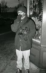 Mr. Bridge giggles like a Japanese schoolgirl (teh hack) Tags: street bridge people bw film mike analog canon person photography photo edmonton candid flash trix rangefinder nb ave alberta 400 ilford strobe whyte ddx a35f