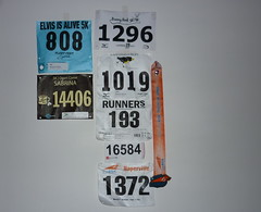 Race number bibs tacked up on the wall