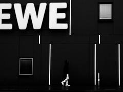 contrast (Sandy...J) Tags: olympus white black blackwhite monochrom streetphotography photography walking man lines urban noir darkness