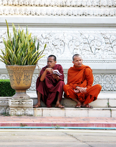 Even monks' feet get sore after a long day of touring at Royal Palace - Phnom Penh, Cambodia