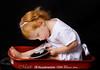 Monkey in the Mirror (FLPhotonut) Tags: red portrait baby wagon mirror homestudio punki canon50d flphotonut