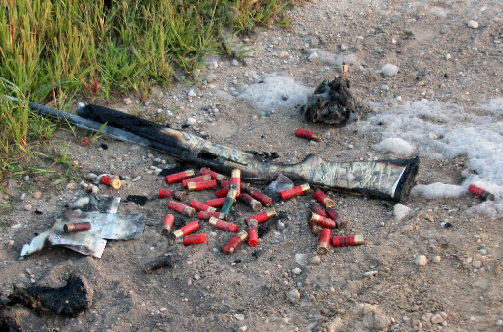 Burnt 12 Gauge Shotgun & Shells Pulled Out of the Cab of the Truck After the Fire