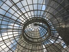 Looking up, I saw ... (peggyhr) Tags: blue friends sky white canada glass lines vancouver clouds buildings bc circles transparent 0007 pacificcentre globalvillage2 peggyhr lunarvillage georgiaandhowe streetlevelentrance