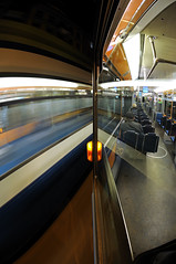 TRaMSuRFeR #II (Toni_V) Tags: city longexposure urban motion blur topv111 night reflections schweiz switzerland movement zurich perspective tram fisheye zürich 2009 d300 20minuten vbz 10528 dsc3000 toniv öffentlicherverkehr 090926