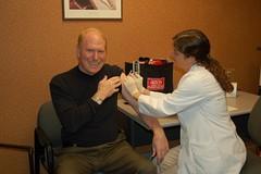Tom Menighan Receives His Seasonal Flu Vaccination From Pharmacist Jessie Evans
