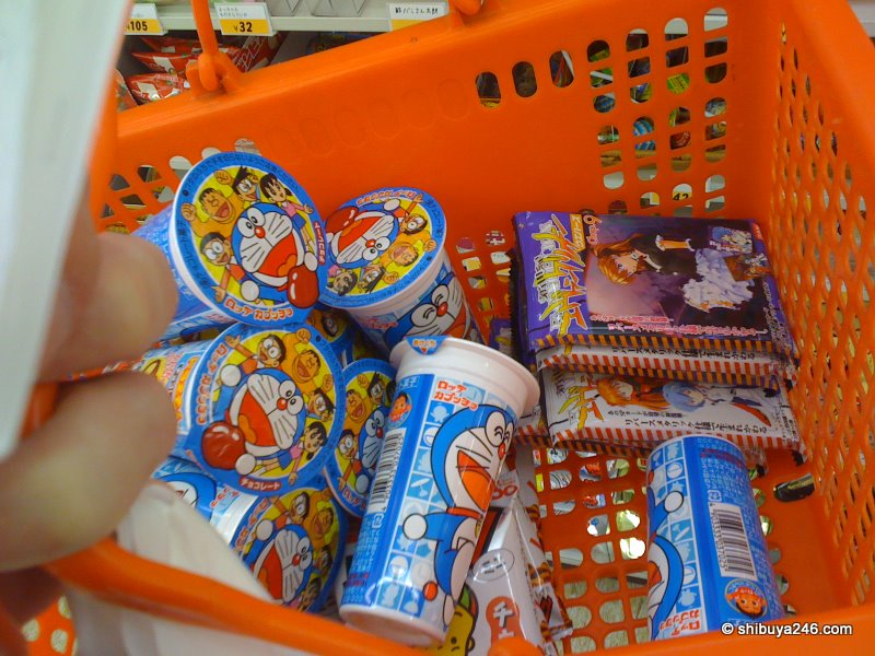 Lots of Doraemon snacks and some EVA cards going into the Conbini Box.