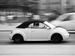 Black Wheels (polarapfel) Tags: street city bw car germany europe action hamburg vehicles nostalgia transportation symbols panning lifestyles jungfernstieg