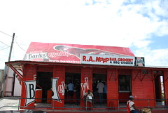 Red Rum Shop & Grocery (cleofysh) Tags: red vacation island bbq tropical barbados caribbean grocery banks rumshop banksbeer february2009 ramapp