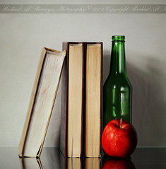 00.1 (Mashael Al-Shuwayer) Tags: food green apple digital canon eos book bottle 85mm saudi arabia saudiarabia 2009 alkhobar 400d mashael alshuwayer