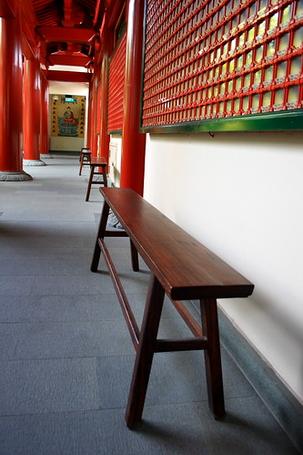 Wooden benches on the long corridor
