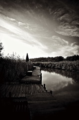 Rickety Dock In Deale (Baab1) Tags: sunset blackandwhite water monochrome sepia clouds docks reflections boats landscapes shadows decay piers maryland rivers beaches snakes creeks chesapeakebay rottingwood waterscapes blackwhitephotos olddocks oldpiers annearundelcountymaryland dealemaryland southermmaryland